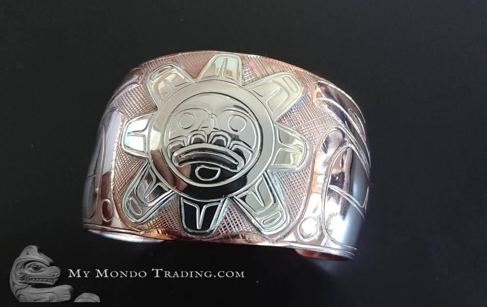 Silver on copper Sun and Raven bracelet by Norman Seaweed