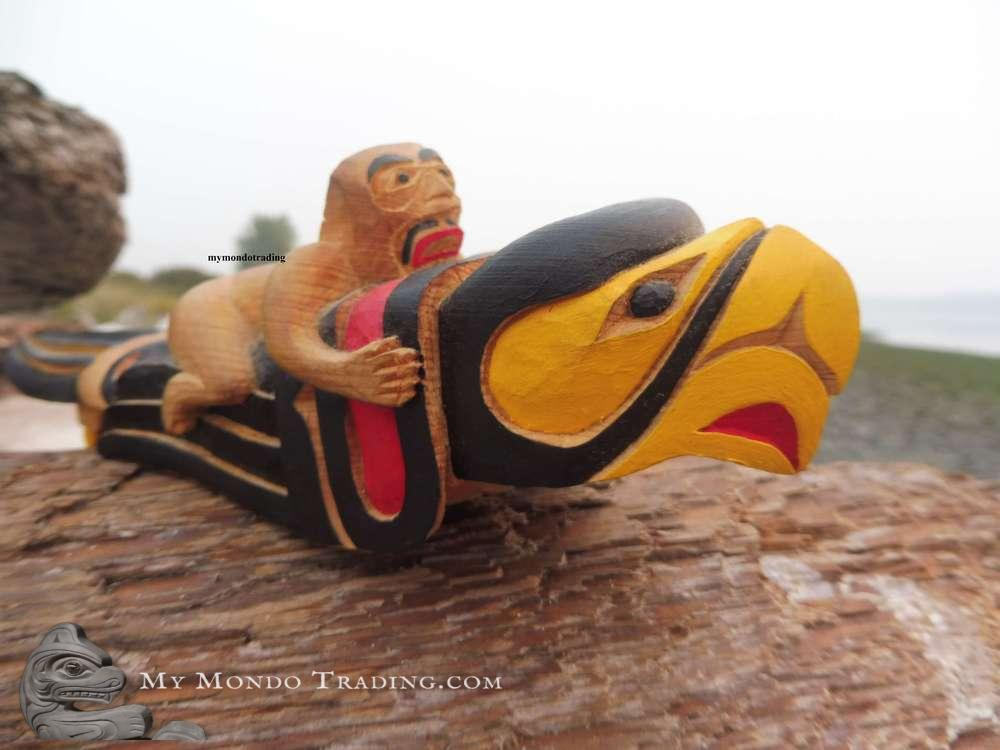 Eagle dance rattle with human riding on top