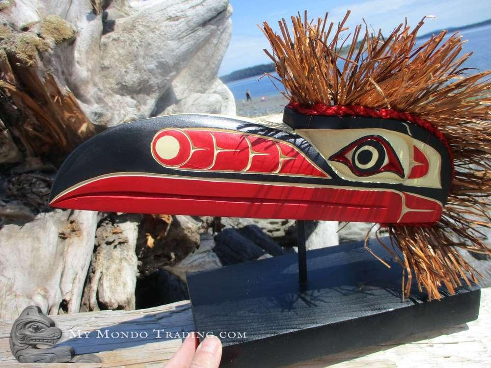 Yellow cedar Raven Mask on stand by Sarah Robertson
