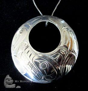 Circular WOLF pendant, sterling silver, by Norman Seaweed