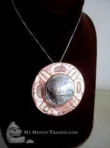 Sterling silver on copper MOON by Norman Seaweed