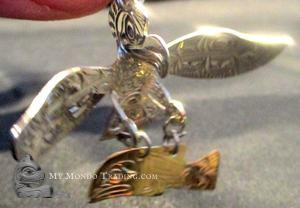Eagle (silver) catching salmon (gold) pendant by Solomon Seward