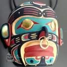 Namgis (Human) mask pendant by Kevin Cranmer