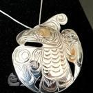 Sterling Silver with gold eye Thunderbird pendant/brooch